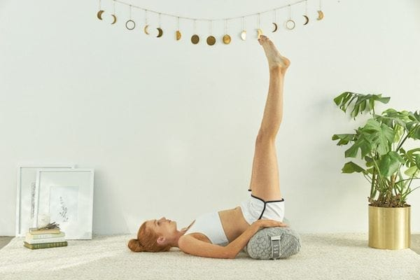 Woman doing supported legs up pose