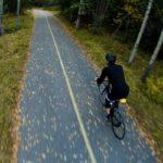 man_biking_on_the_road_to_self-love