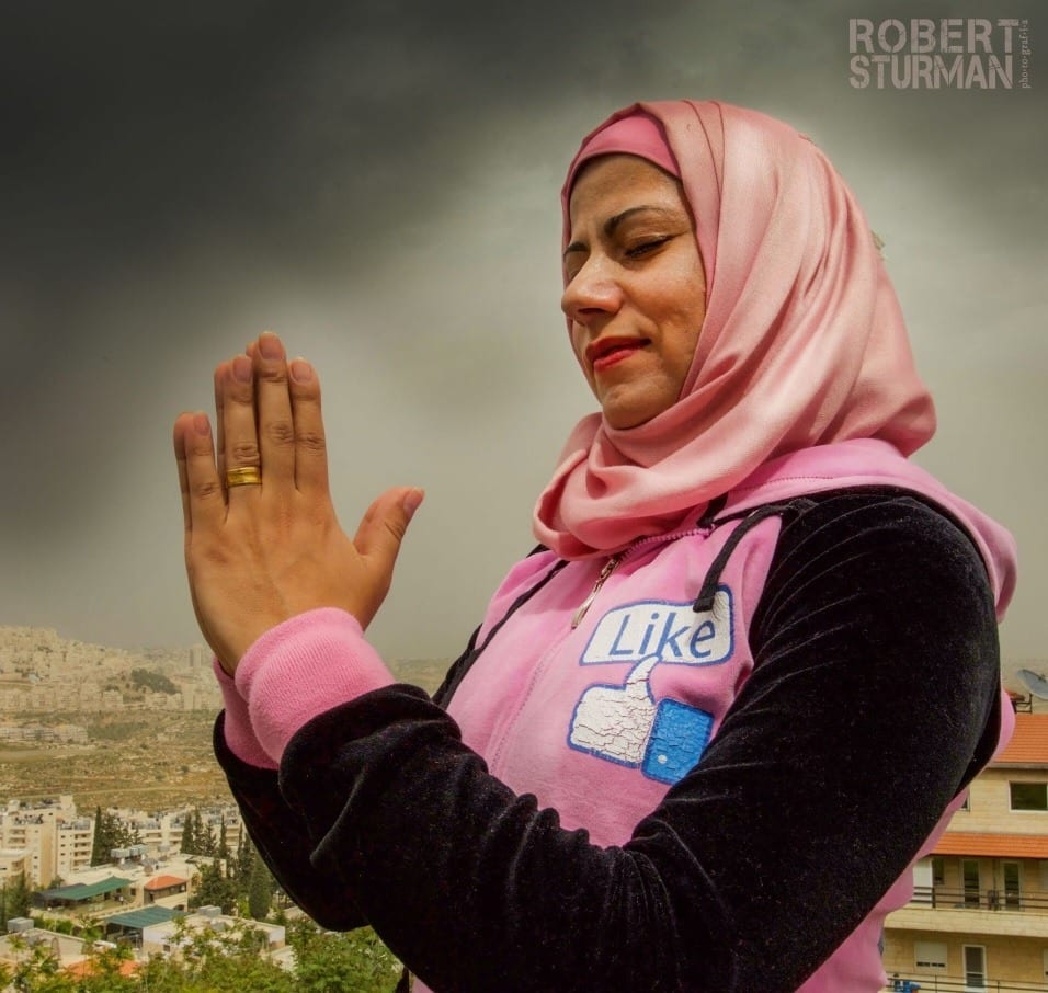 Rula Samer, a prenatal yoga teacher, with her hands in a prayer in Bethlehem, Palestine.
