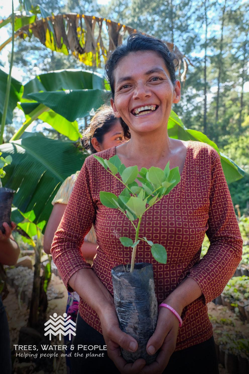 woman holding tree