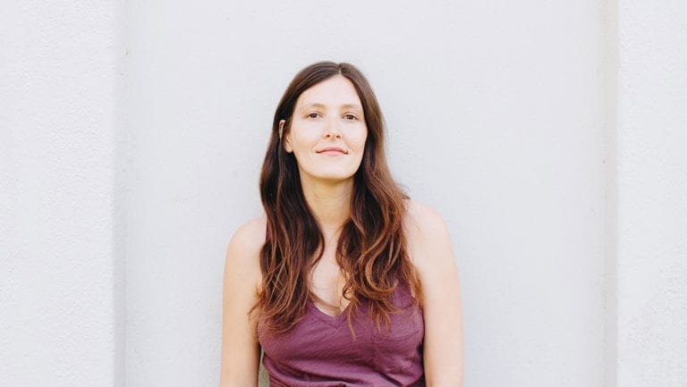 Headshot of breathwork teacher Ashley Neese