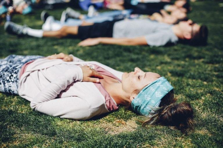 girl breathing on her back