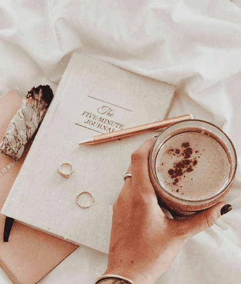 Five-minute journal with a cup of coffee.