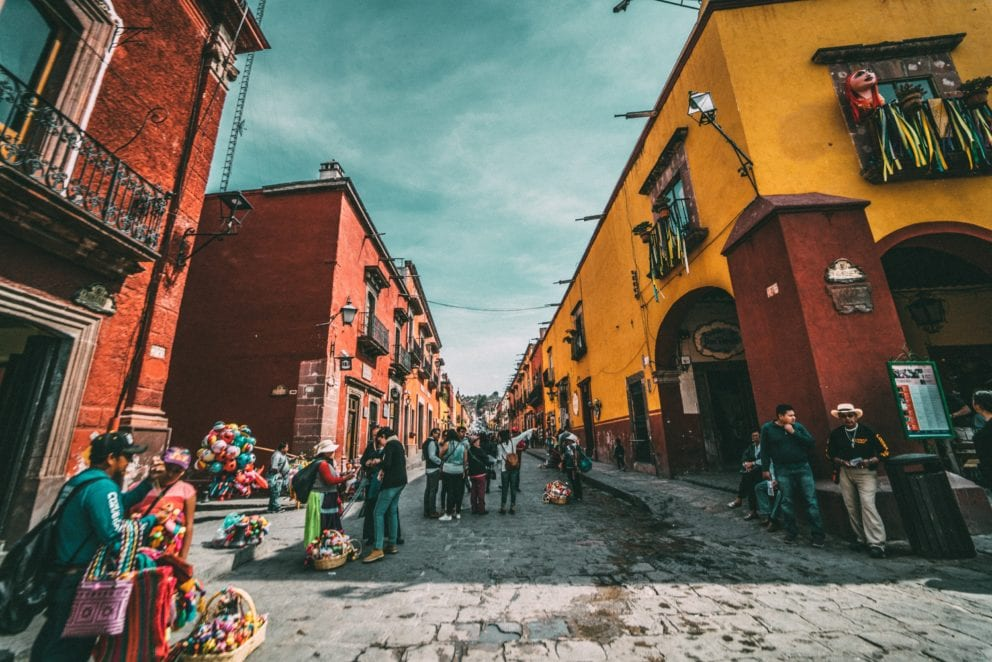 Mexican street with colorful buildings and artisans