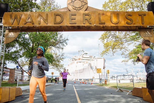 people running across Wanderlust finish line