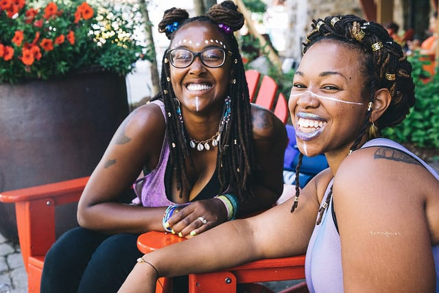 two girls with facepaint at festival