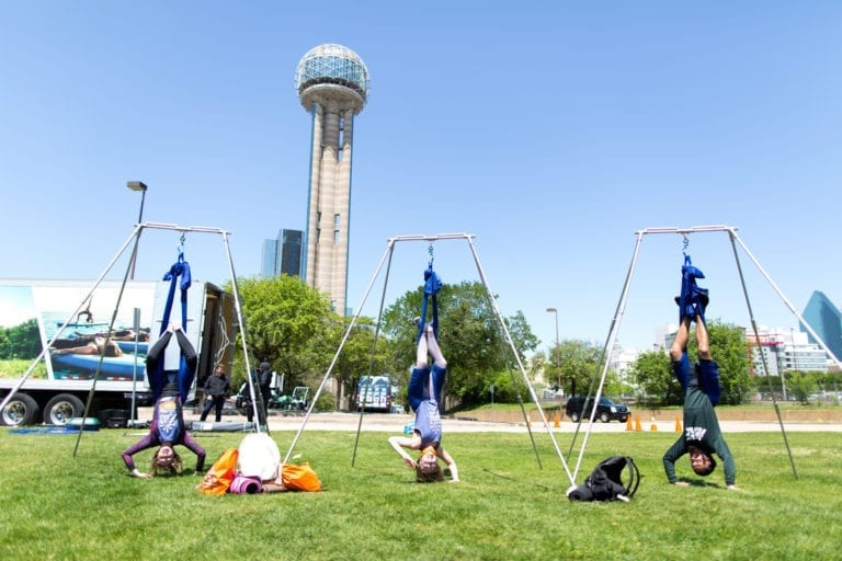 Three people practicing Aireal Yoga at the Dallas 108