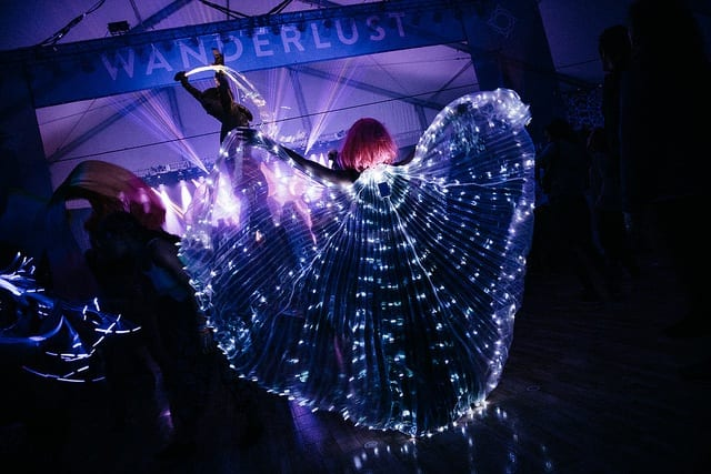 concert with purple lights and lit butterfly wings spread