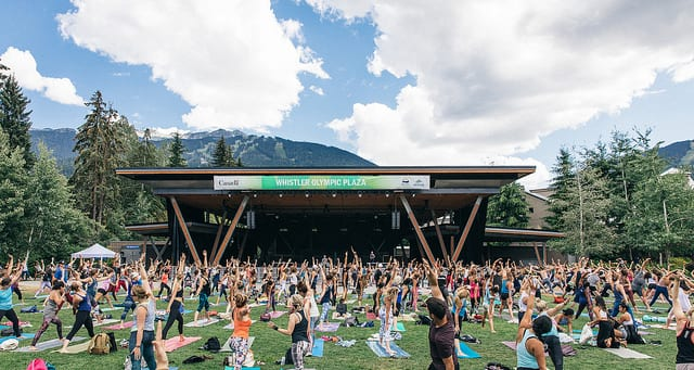 people doing yoga in whistler olympic plaza