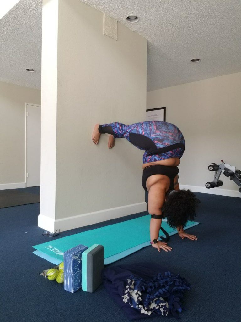 woman in inversion against wall with legs up wall