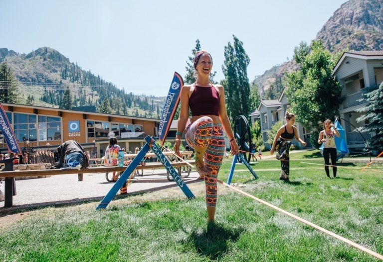 woman on slackline in mountain town