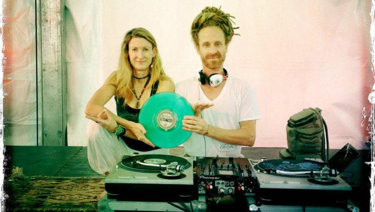 janet stone and dj drez with records spinning