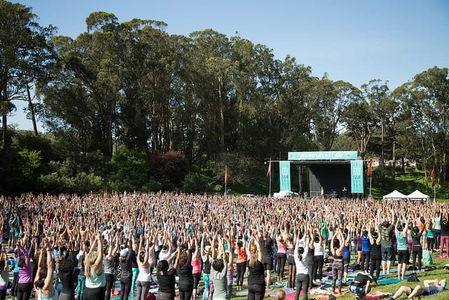 large scale outdoor yoga class wanderlust festival