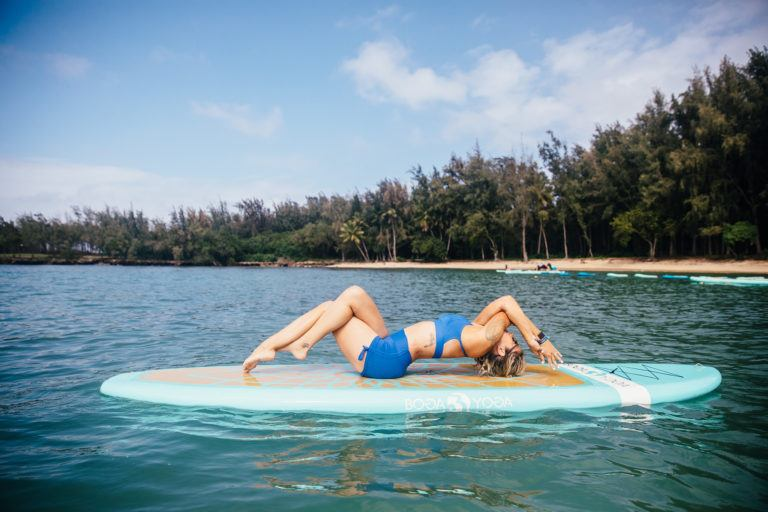 woman in yoga pose on lake in Hawaii