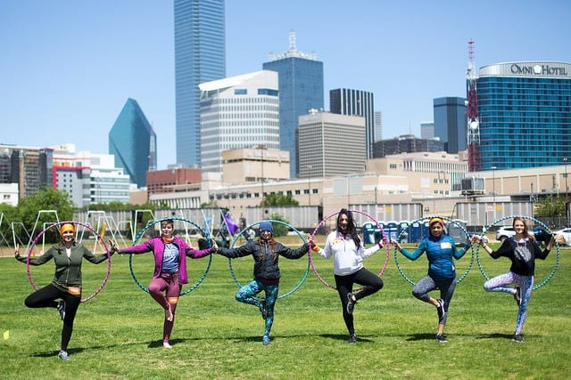 people with hula hoops with dallas
