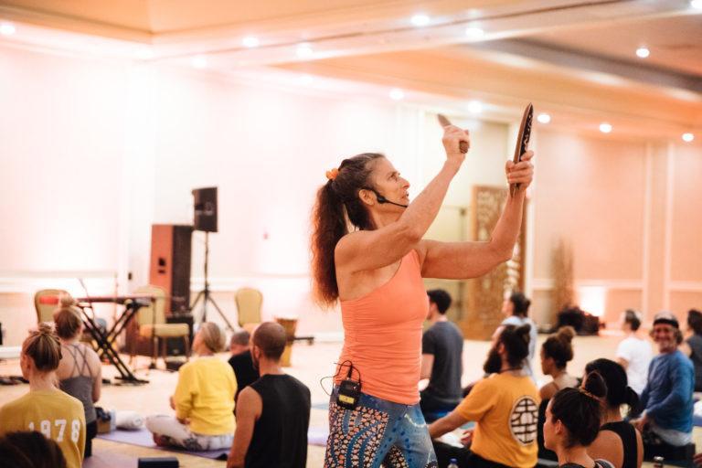 woman yoga teacher playing sticks