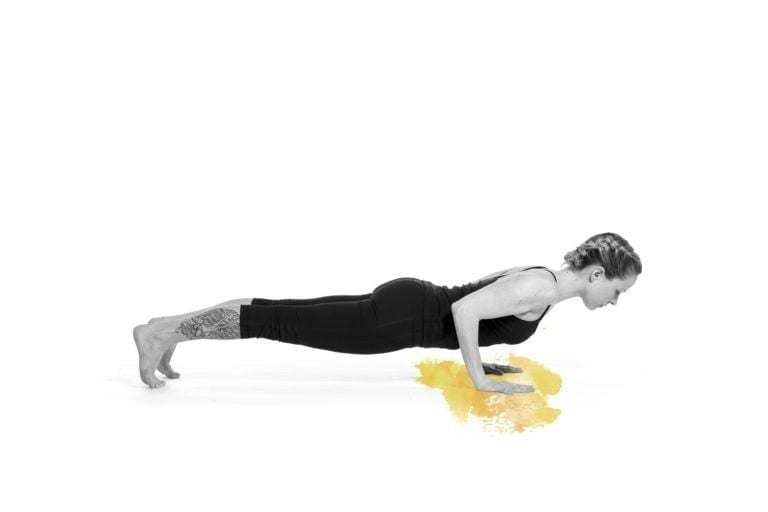 woman in chaturanga pose