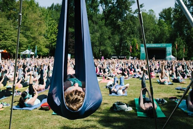 woman in aerial rig with yoga class