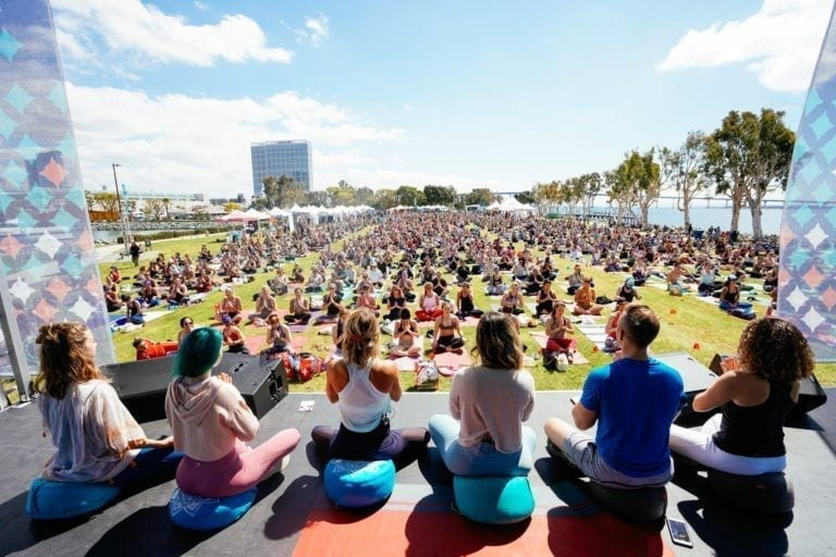 people teaching meditation on stage
