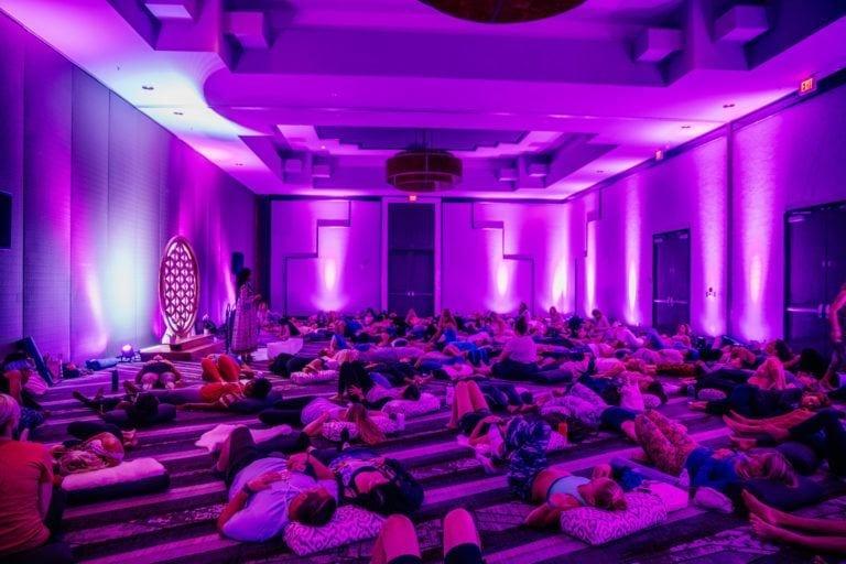 woman teaching sound journey in purple room