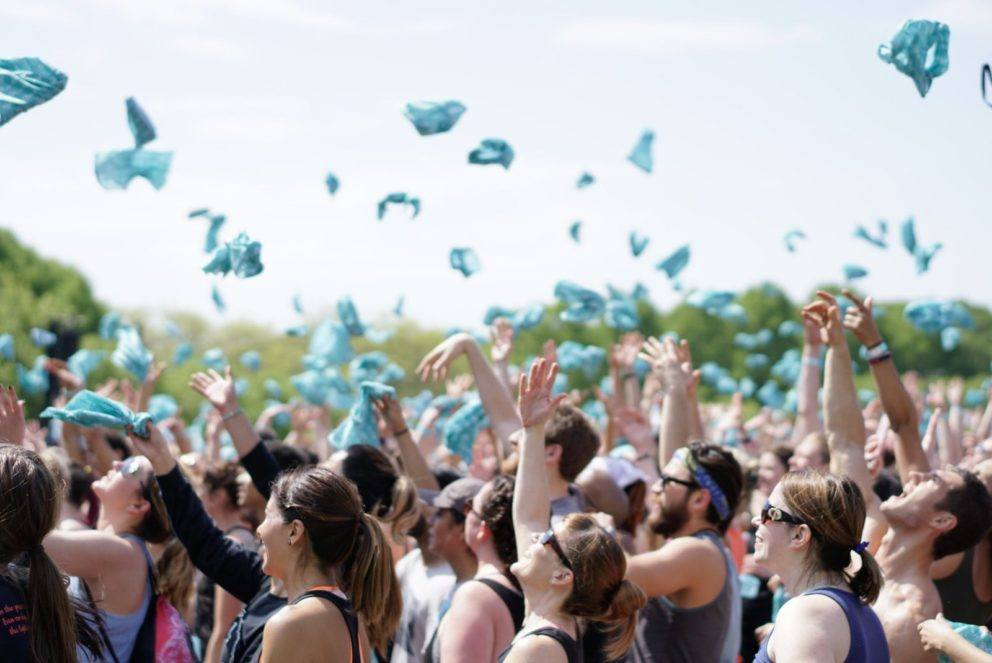 throwing bandanas up in crowd blue sky