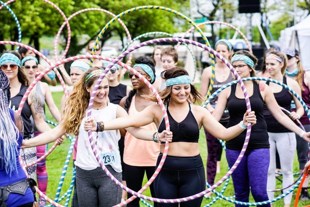 group of people with hula hoops