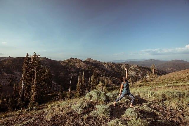 people doing yoga on mountain