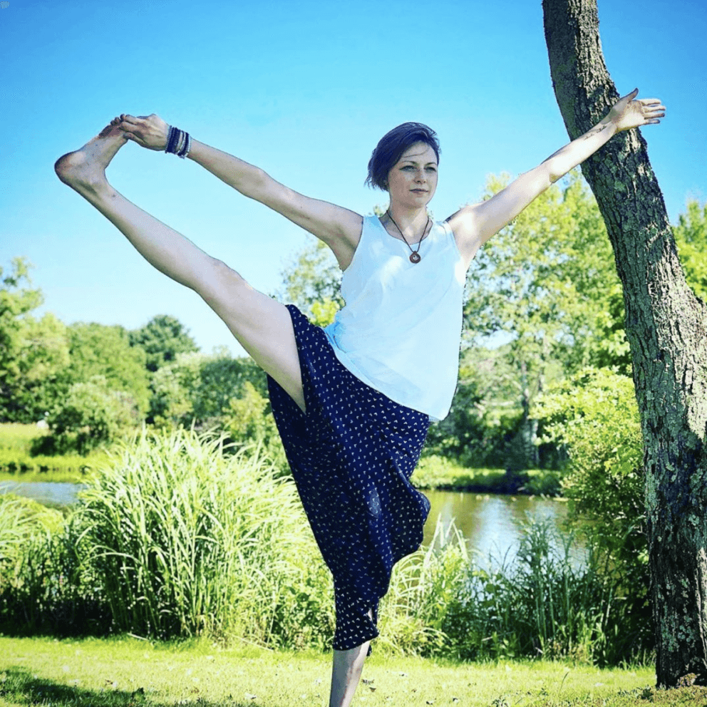 woman in yoga pose lake