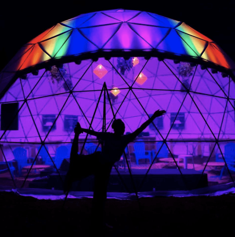 woman in dancers pose dome rainbow