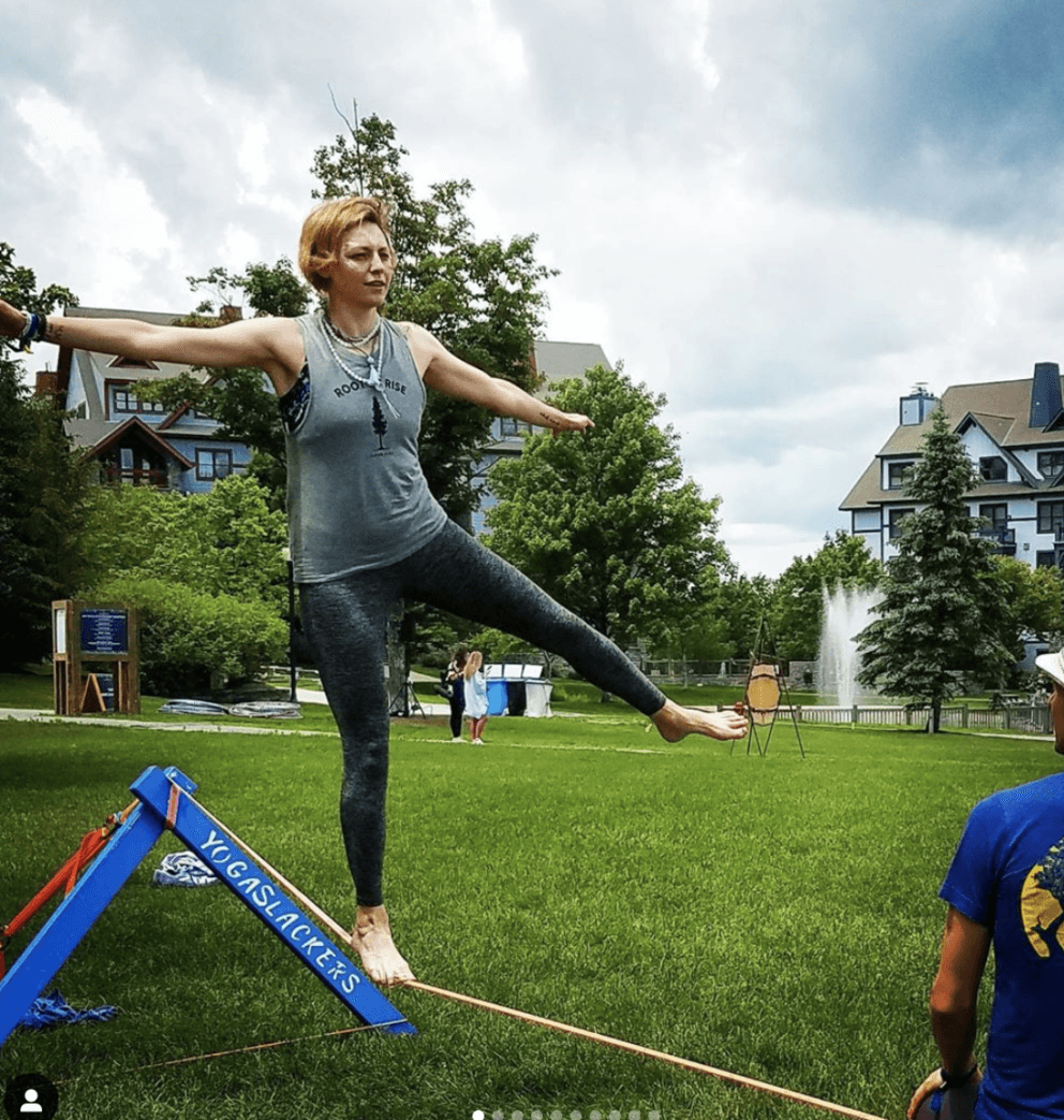 woman doing slacklining at festival